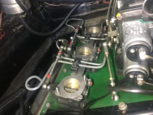 MFI throttle bodies refitted with link rods